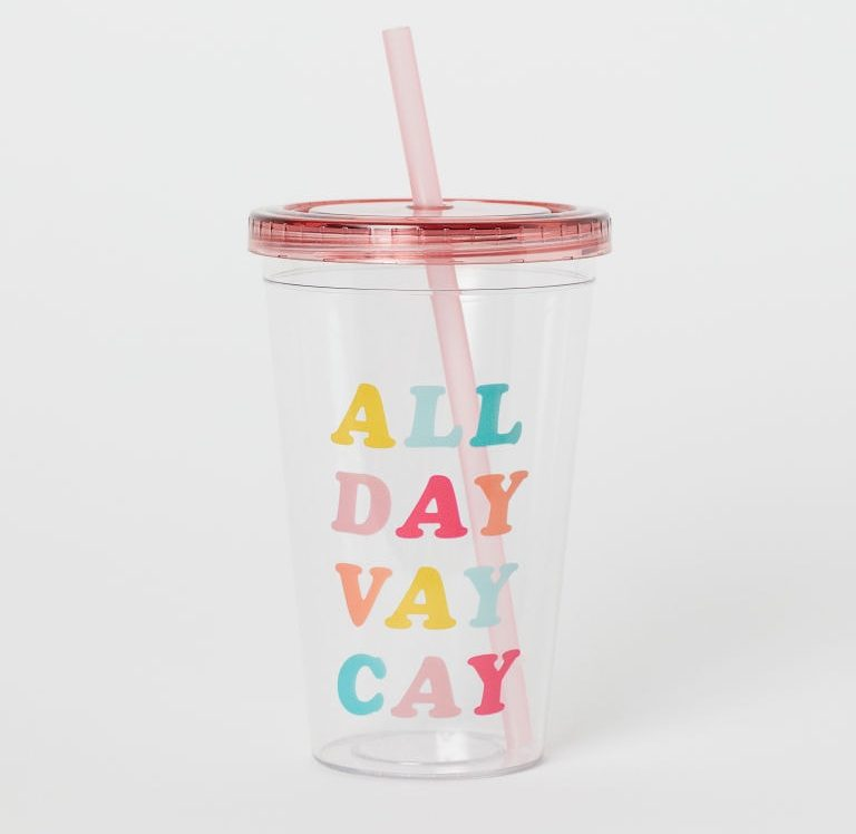 photo of a plastic tumbler with text