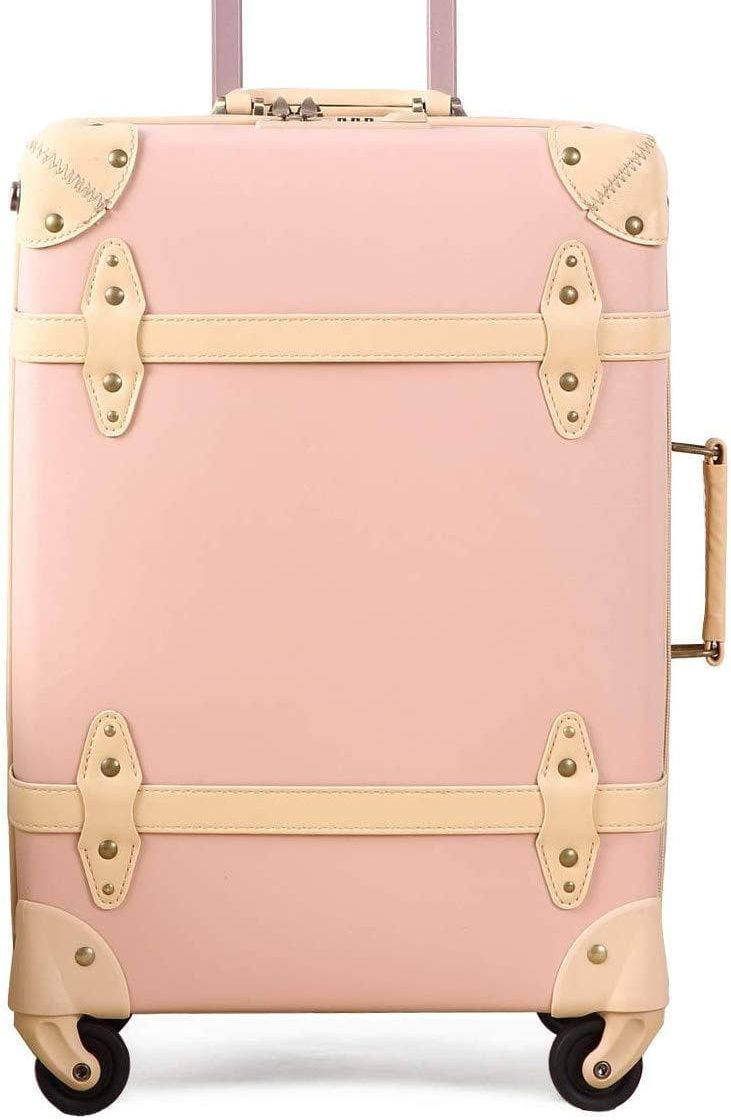 photo of a pink vintage carry on luggage