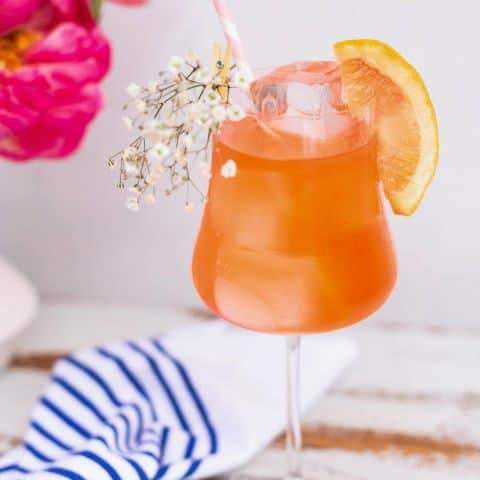 photo of the Elderflower Aperol Spritz cocktail recipe garnished with baby breath by top Houston lifestyle blogger Ashley Rose of Sugar & Cloth