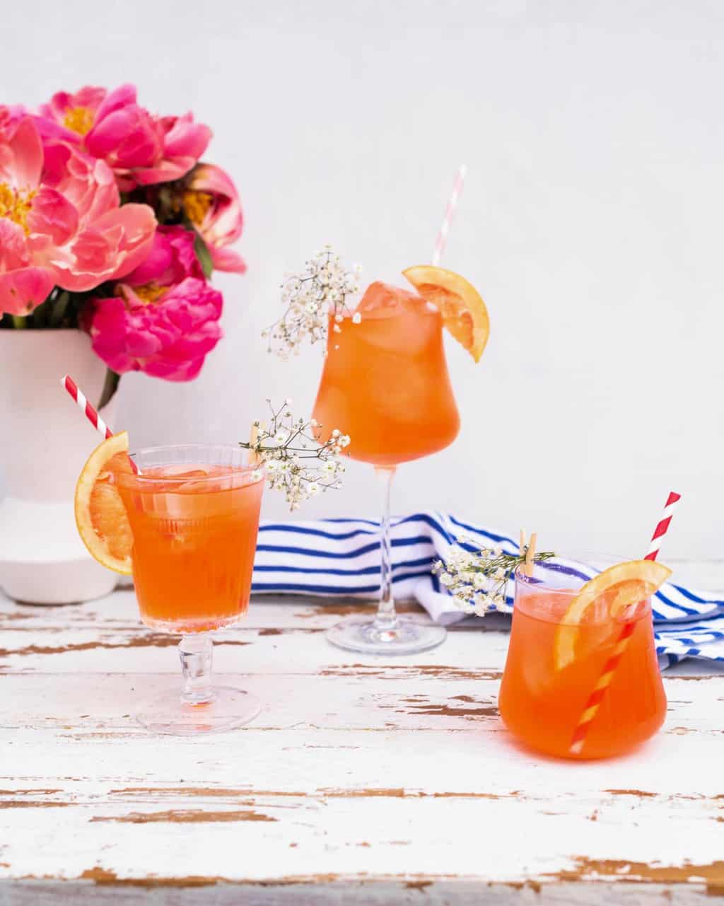 photo of three Elderflower Aperol Spritz cocktails by top Houston lifestyle blogger Ashley Rose of Sugar & Cloth