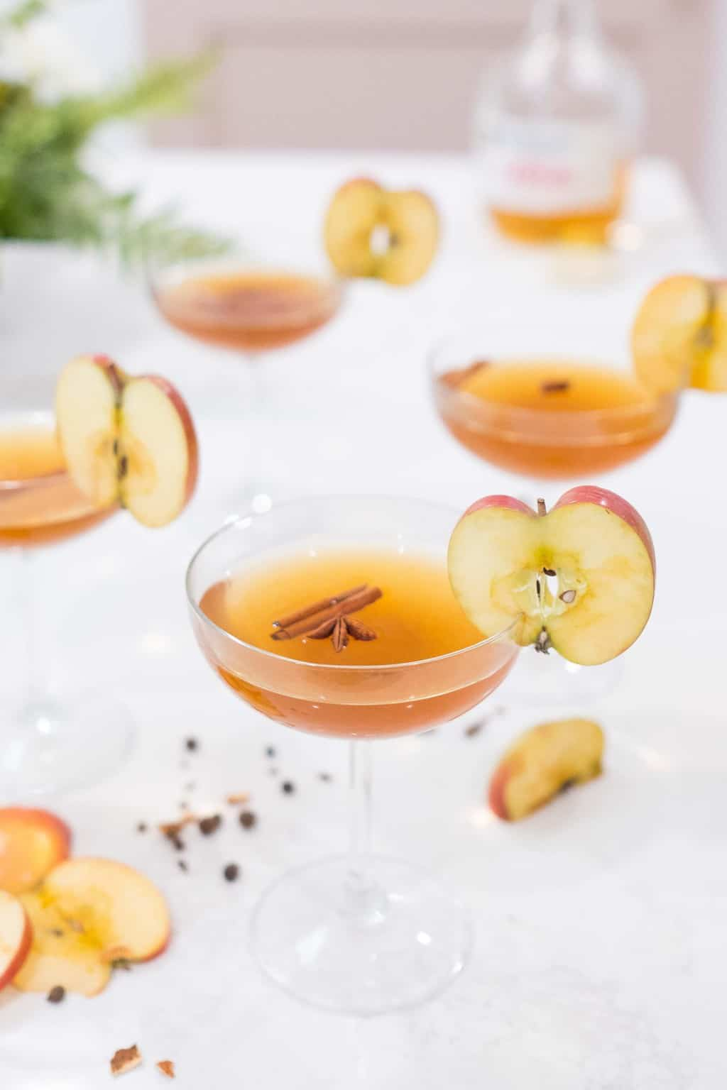photo of the photo of the easy spiced apple cider drink apple and cinnamon stick garnishes by top Houston lifestyle blogger Ashley Rose of Sugar & Cloth