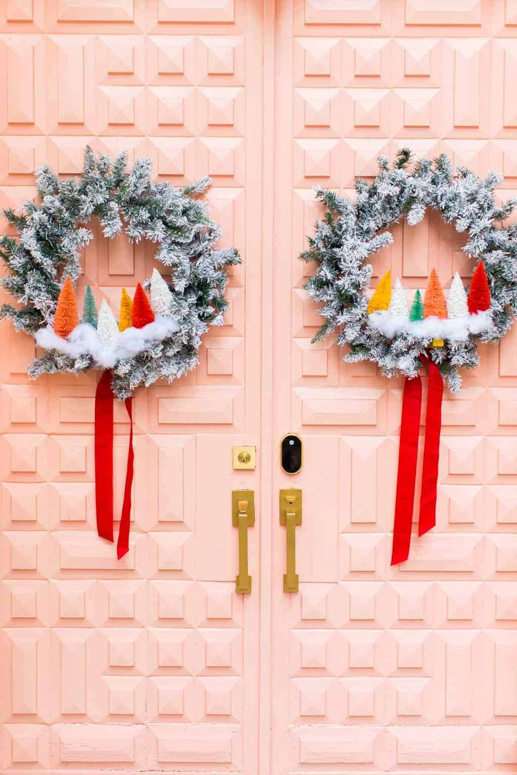 photo of double pink doors with wreaths for Christmas