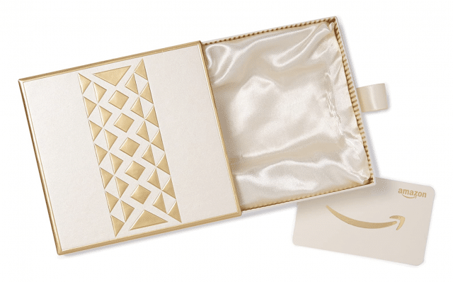 a white and gold amazon gift box with gift card idea
