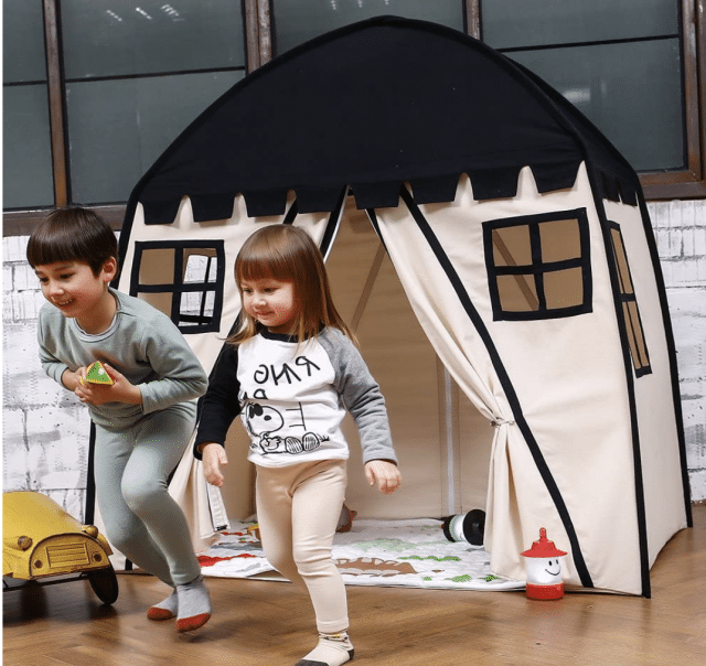 photo of an indoor house tent with kids playing