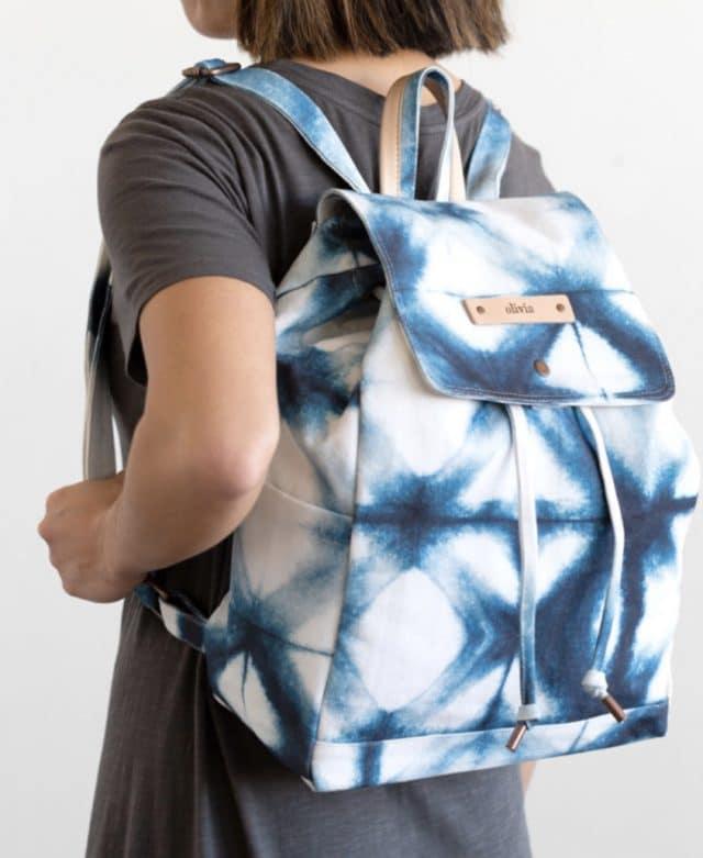 girl carrying a custom backpack