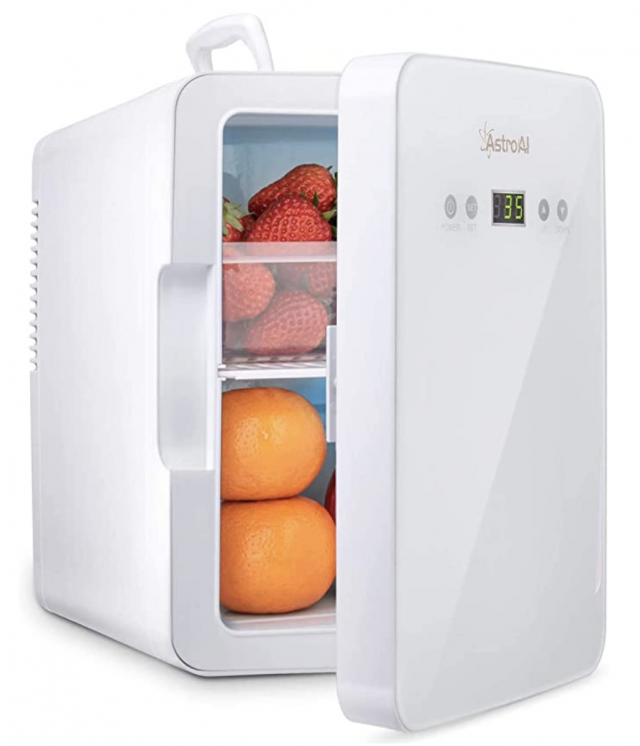 a small white portable fridge cooler and warmer with fruit inside as a gift idea for women