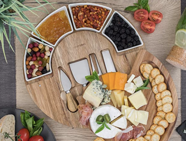 a full serving board and cheese plate set gift idea with charcuterie on it