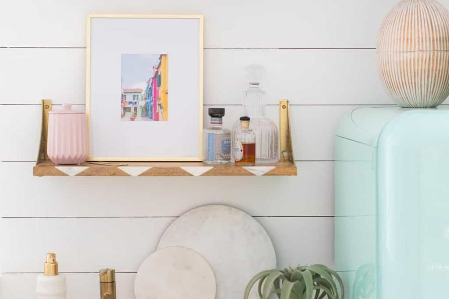 photo of open shelving over top of a wet bar