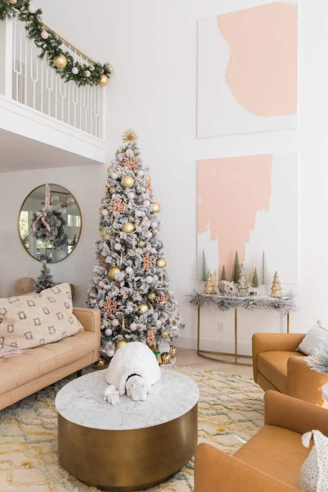 10 ft christmas tree and abstract pink decor in living room