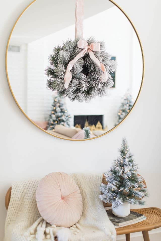 christmas wreath on a mirror with bench