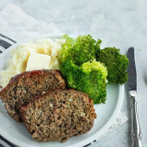 photo of the best easy meatloaf with a side of mash potatoes and broccoli by top Houston lifestyle blogger Ashley Rose of Sugar & Cloth