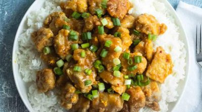 photo of the easy orange chicken recipe by top Houston lifestyle blogger Ashley Rose of Sugar & Cloth