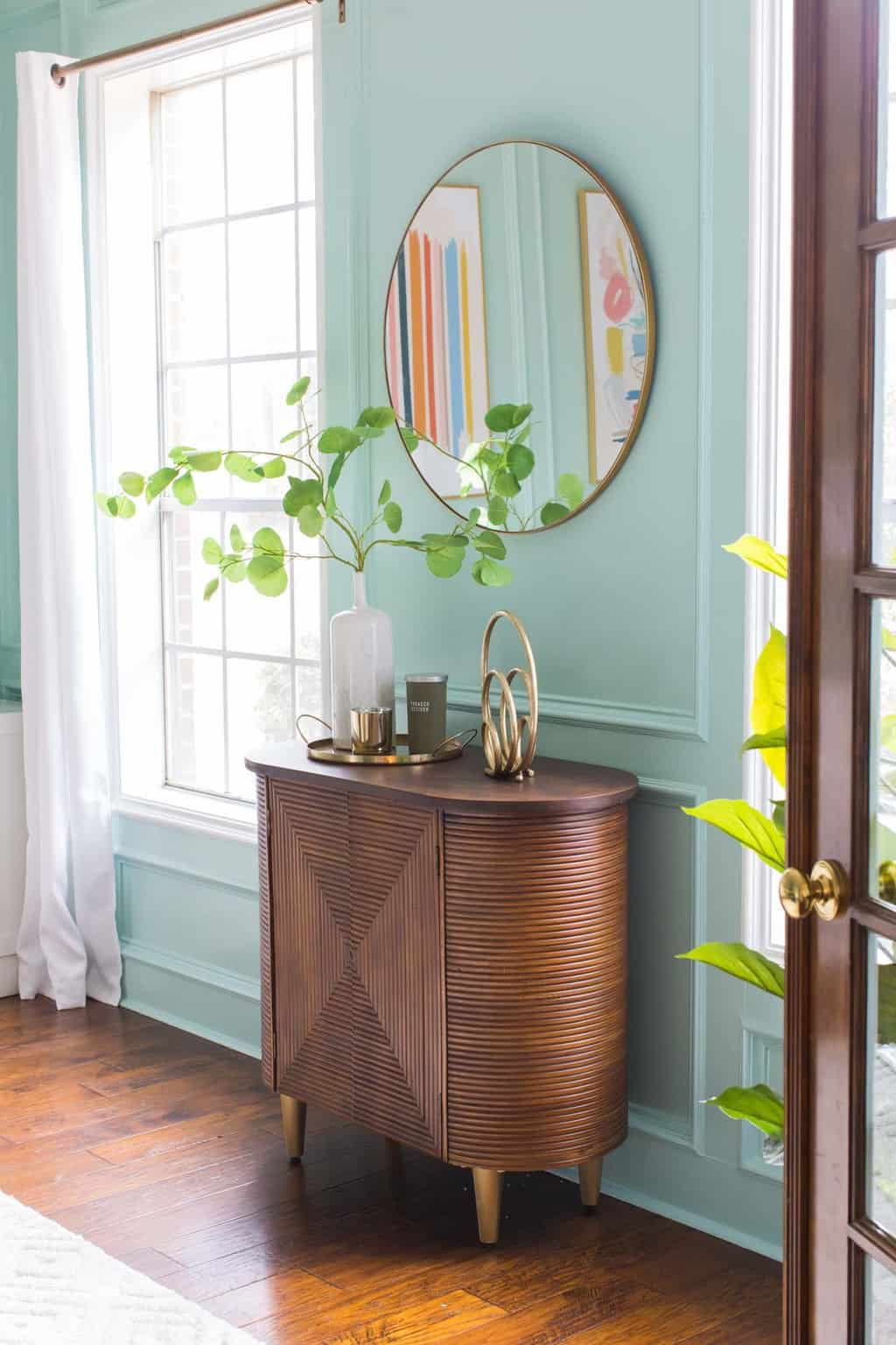 wooden credenza with windows
