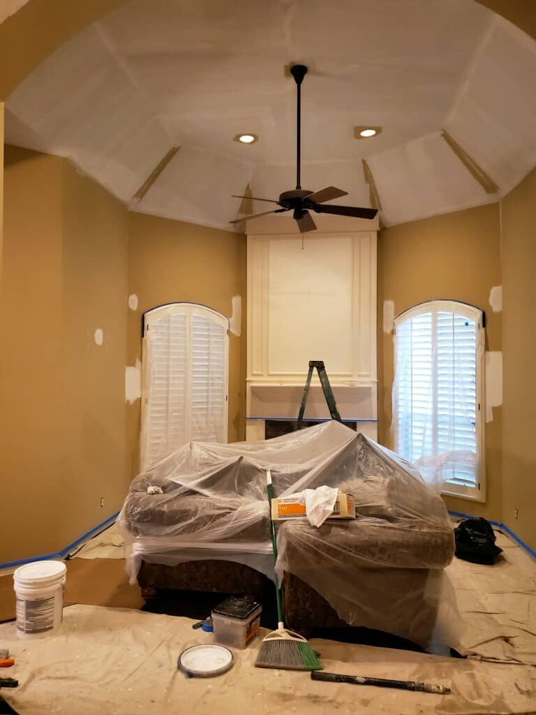 photo of the living room being painted to brighten up the space by top Houston lifestyle blogger Ashley Rose of Sugar & Cloth