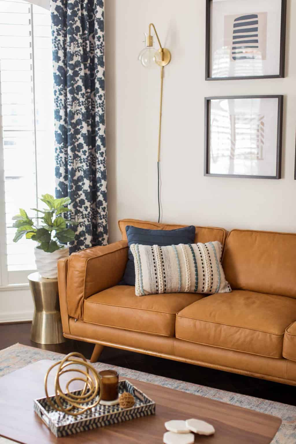 photo of the new modern mid-century couch in the living room makeover by top Houston lifestyle blogger Ashley Rose of Sugar & Cloth