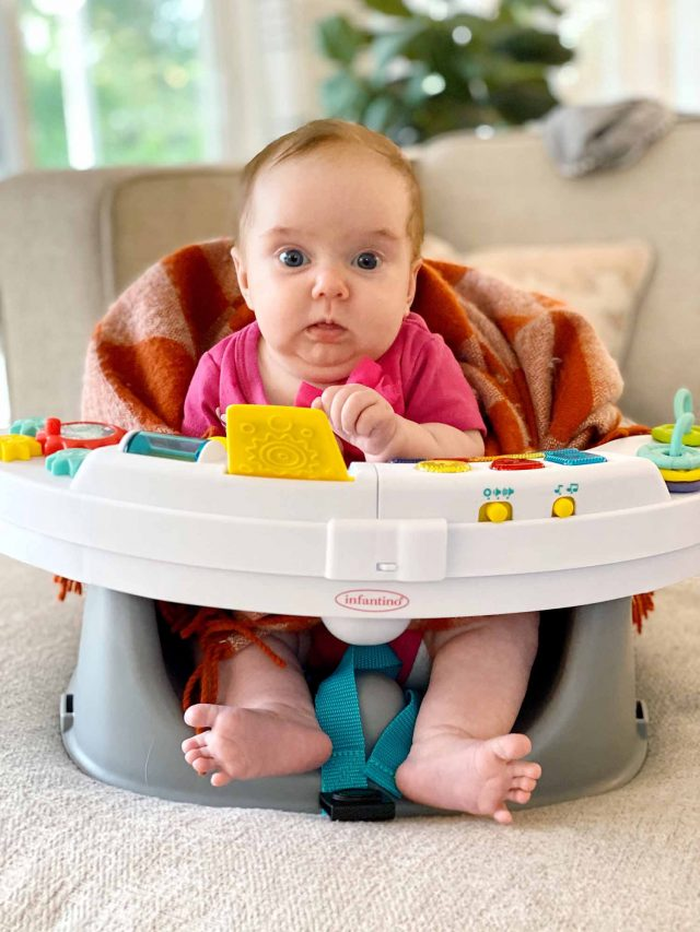 photo of baby in a play chair