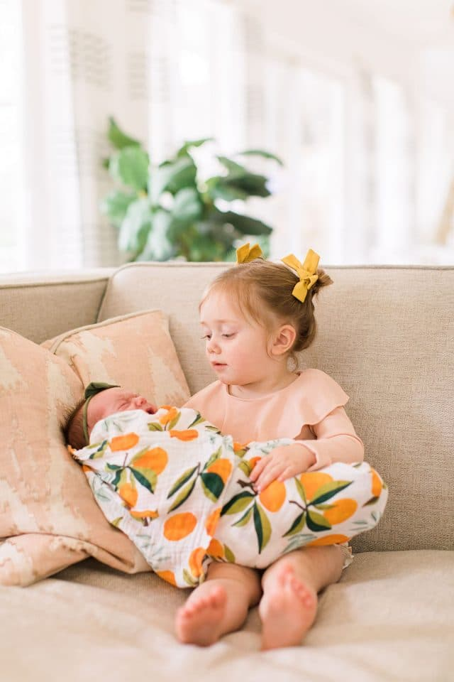 toddler and baby sister newborn photo