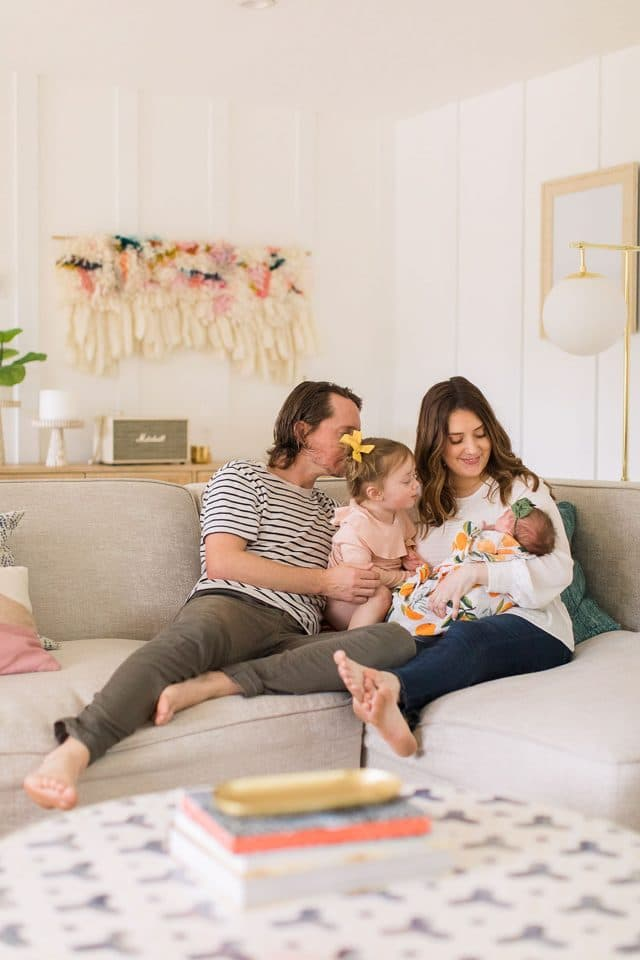 newborn family photo in living room