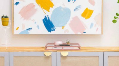 DIY artwork and rattan tv stand