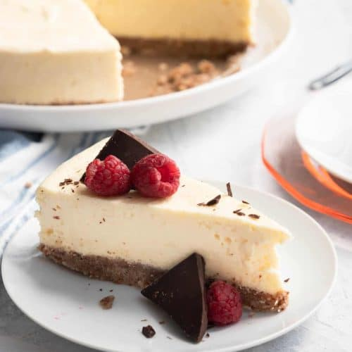 photo of a slice of healthy keto low carb cheesecake by top Houston lifestyle blogger Ashley Rose of Sugar & Cloth