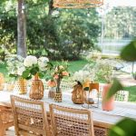 a pretty table scene in the backyard with a basket patio light