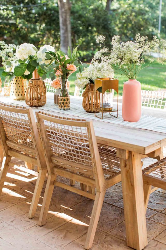 outdoor article dining table and chairs with vases