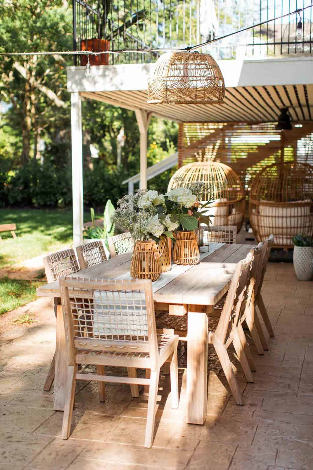 photo of an article teaka outdoor dining table and chairs