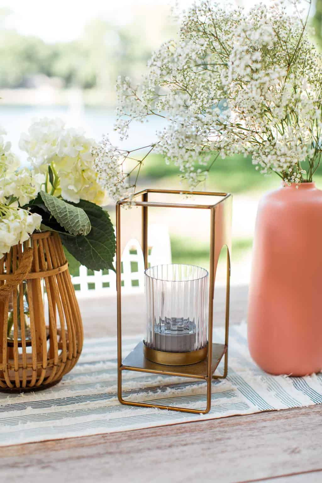 brass lantern on an outdoor table