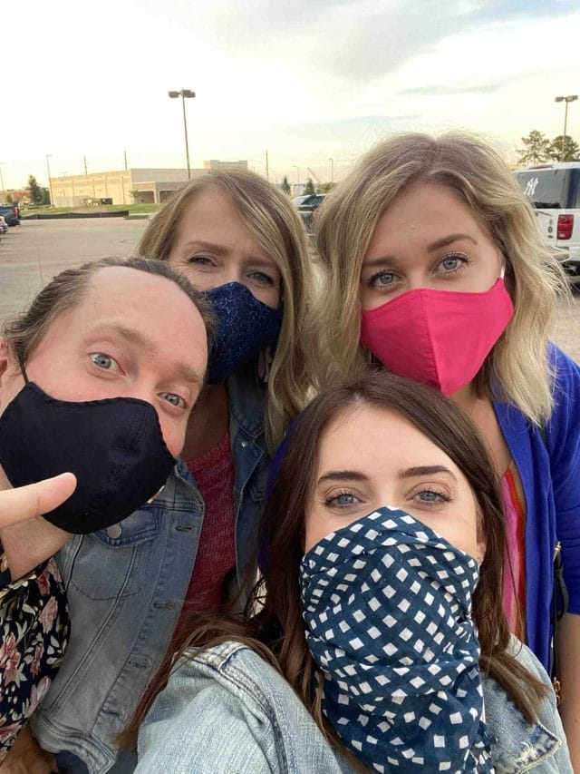 three girls and a guy in masks at cinemark