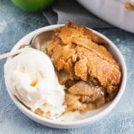 photo of the apple cobbler dessert with a scoop of ice cream by top Houston lifestyle blogger Ashley Rose of Sugar & Cloth