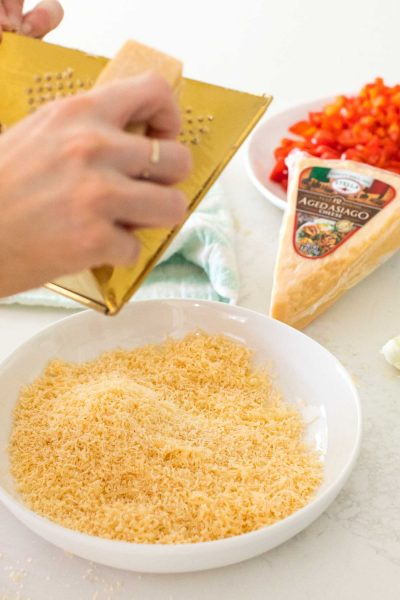 freshly grated stella asiago cheese wedge