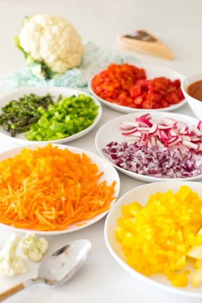 plates of rainbow veggie toppings