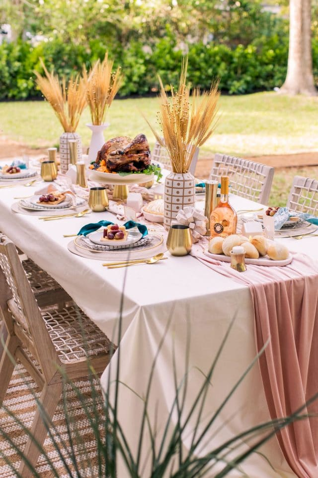 photo of our Thanksgiving table setting and family dinner outside by top Houston lifestyle blogger Ashley Rose of Sugar & Cloth