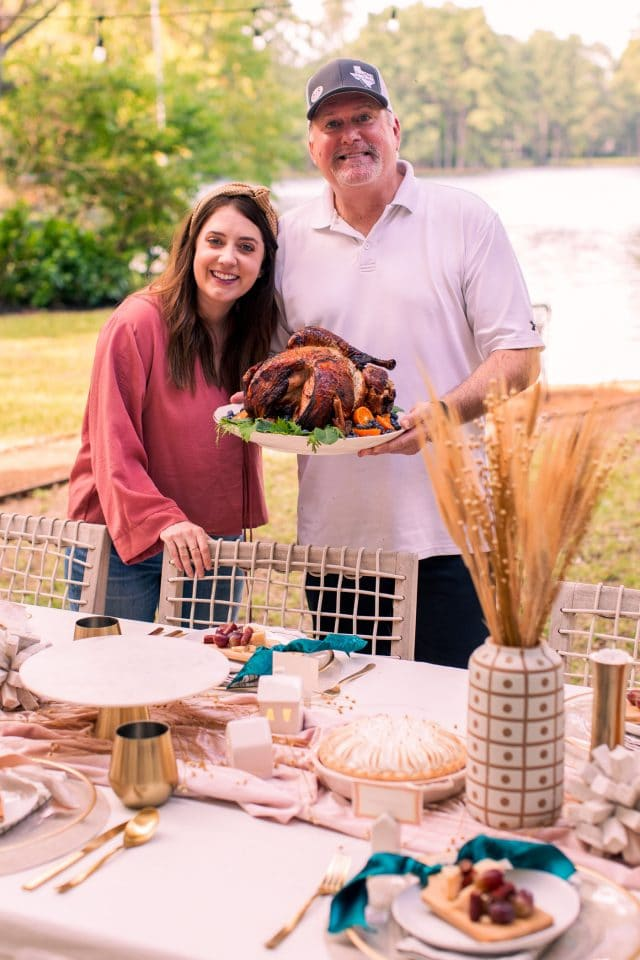 photo of Ashley Rose and her dad after he just finished cooking his family air fryer turkey recipe by top Houston lifestyle blogger Ashley Rose of Sugar & Cloth