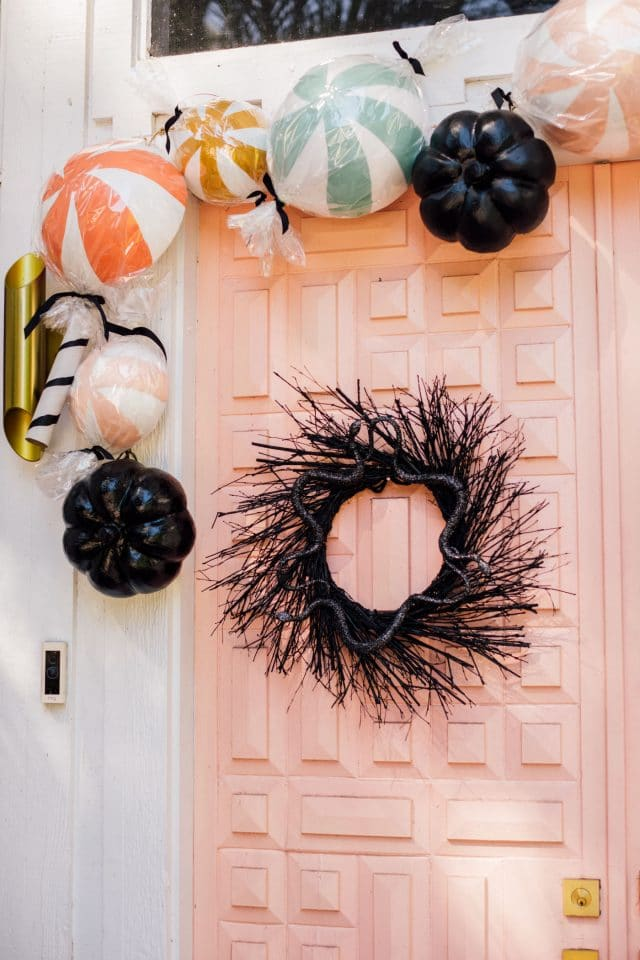 black halloween wreath and pink front door