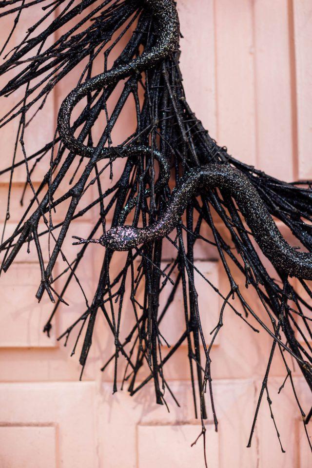 black halloween wreath with snake