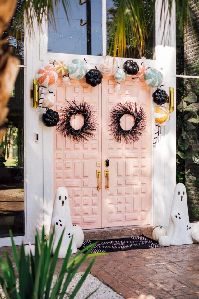 another angle view of pink double doors and halloween decorations