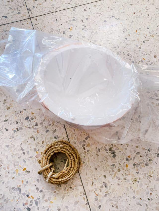 wrapped foam sphere in plastic wrap