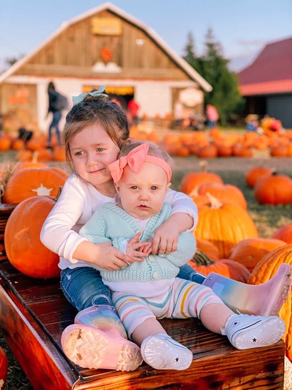 luca and gwen at the pumpkin patch