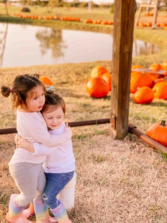 gwen and bobbi hugging at the pumpkin patch