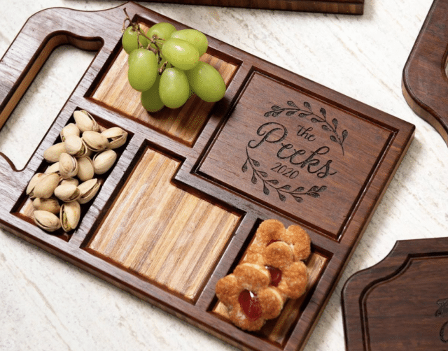 photo of a serving board with fruits and nuts and customized name plate