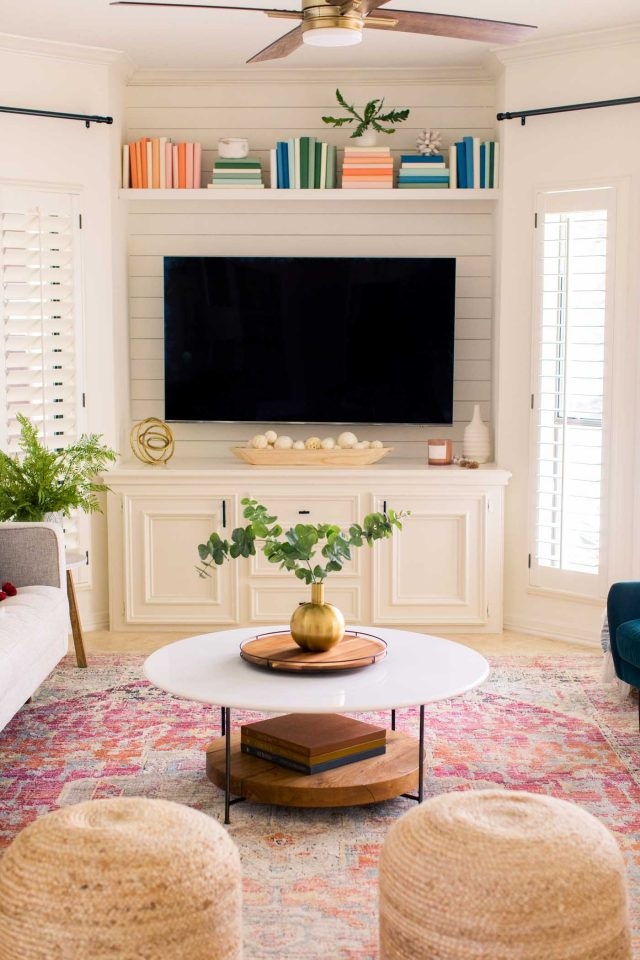 photo of a family room makeover with tv and bookshelf