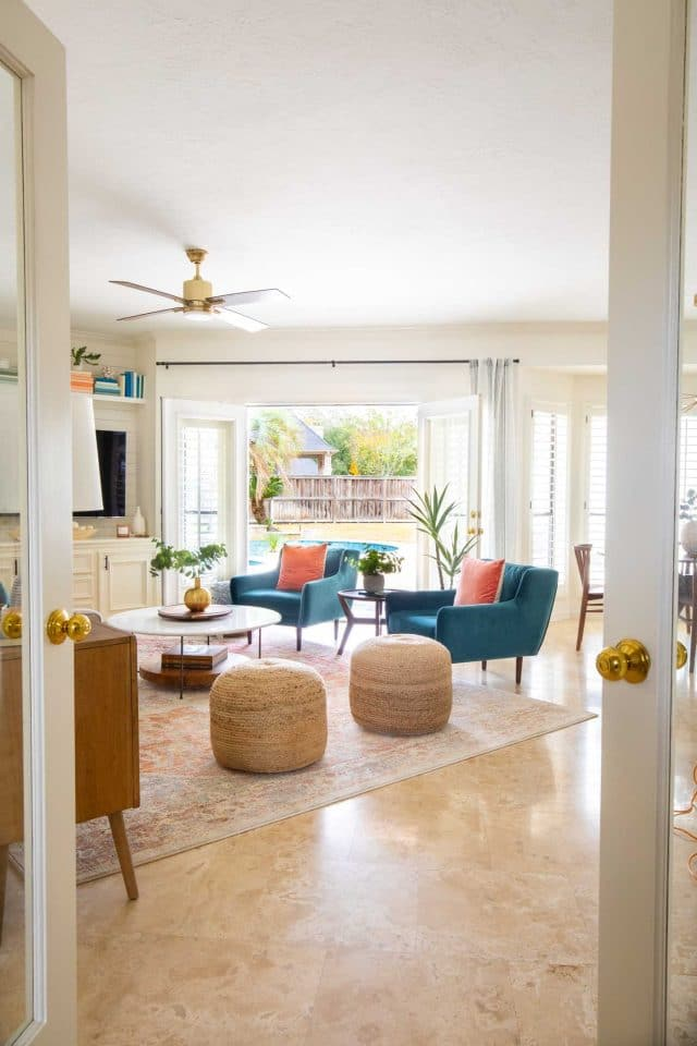 looking between two doors into a family room
