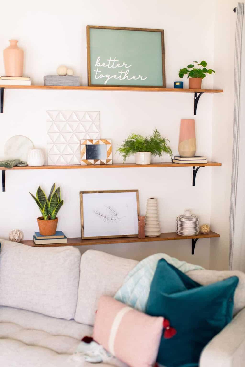 styled bookshelves behind a sofa