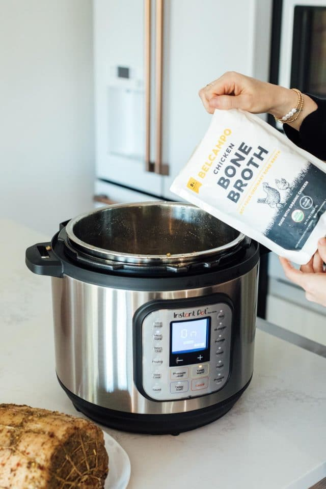 photo of the chicken broth going into the Instant Pot by top Houston lifestyle blogger Ashley Rose of Sugar & Cloth