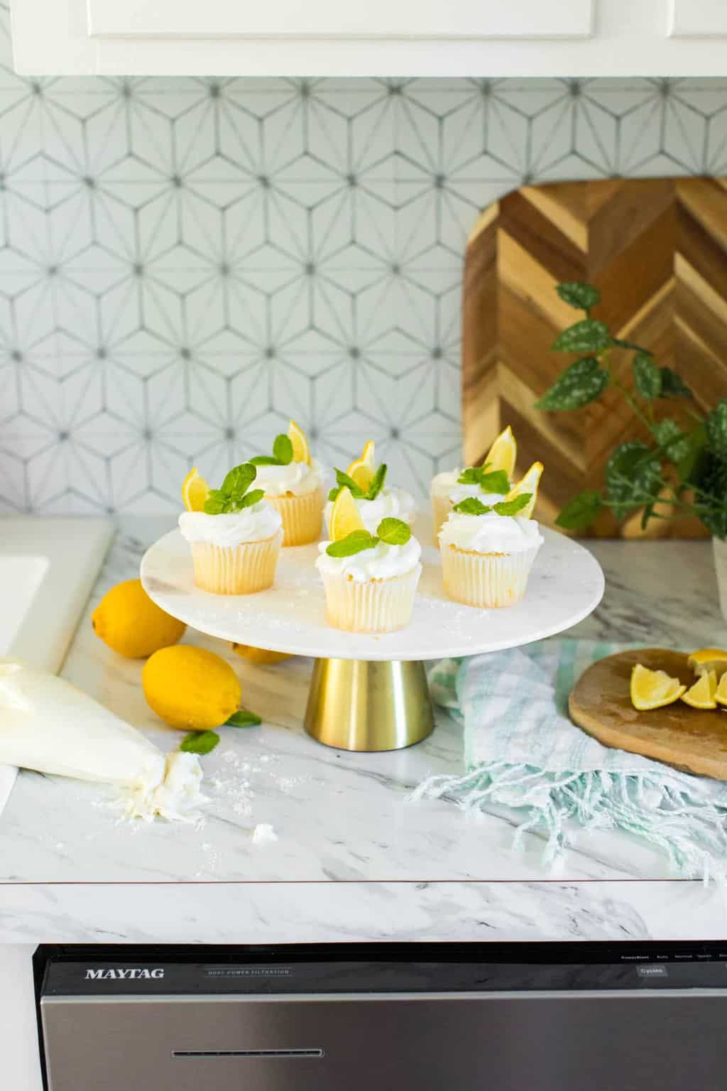 photo of lemon wedges and mint sprigs on lemon cupcakes by top Houston lifestyle blogger Ashley Rose of Sugar & Cloth