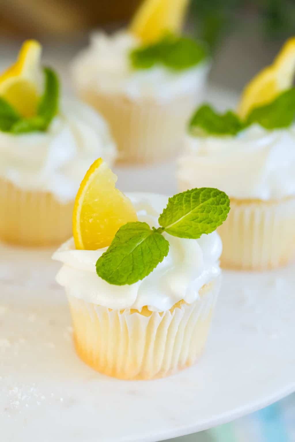 close up photo of the lemon cupcakes with lemon flavor frosting by top Houston lifestyle blogger Ashley Rose of Sugar & Cloth