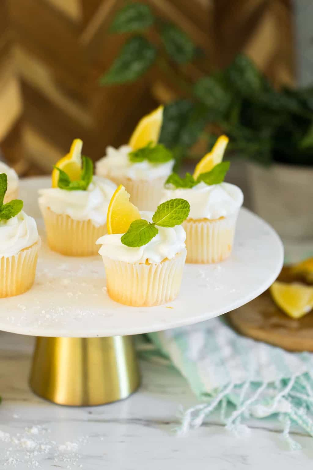 photo of the lemon cupcakes on a cake stand by top Houston lifestyle blogger Ashley Rose of Sugar & Cloth