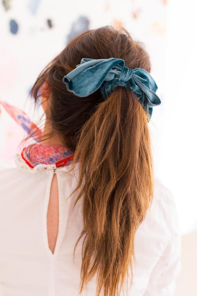 close up photo of a velvet scrunchie hair accessory by top Houston lifestyle blogger Ashley Rose of Sugar & Cloth