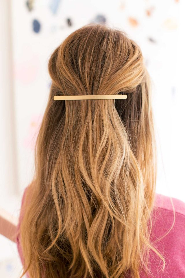photo of a half back hair with an accent clip for easy dirty hair hairstyles by top Houston lifestyle blogger Ashley Rose of Sugar & Cloth